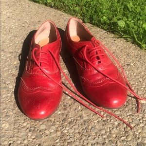 Red leather tie shoes